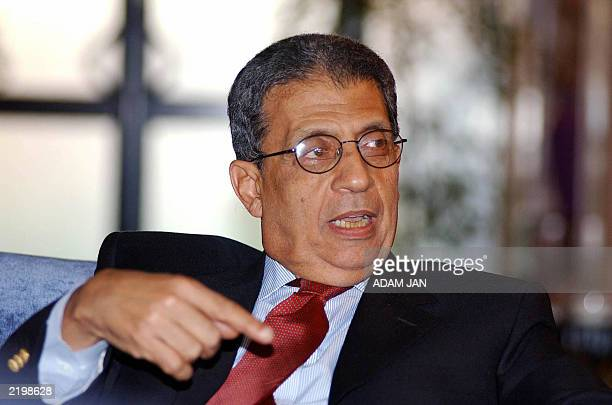 Secretary General of the Arab League Amr Moussa talks to the press in Manama 09 June 2003 Mussa is in Bahrain to participate in the Arab foreign...