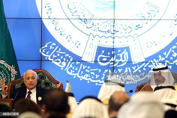 Secretary General of the Arab League Nabil alAraby speaks to the press as Kuwaiti Foreign Minister Sheikh Sabah alKhaled looks on during a press...