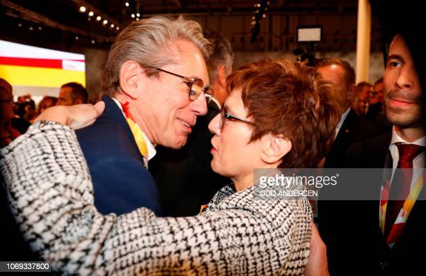 Secretary General of the Christian Democratic Union Annegret KrampKarrenbauer is greeted by a delegate as she arrives for a party congress of...
