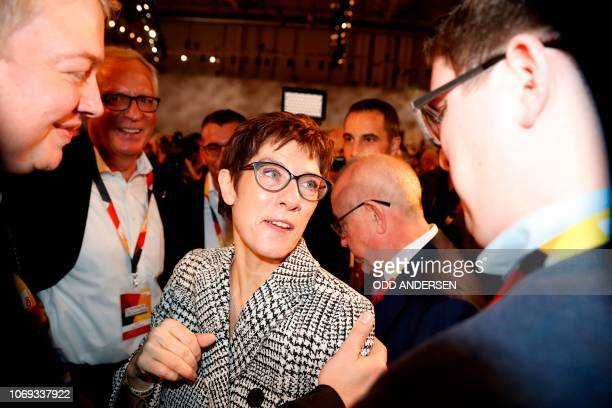 Secretary General of the Christian Democratic Union Annegret KrampKarrenbauer is greeted by delegates as she arrives for a party congress of...