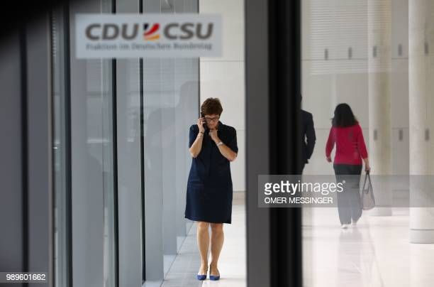 Secretary General of the Christian Democratic Union Annegret KrampKarrenbauer is seen on the phone in the corridors of the Parliament compound prior...
