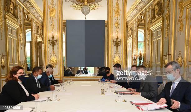 Secretary General of the Elysee Palace Alexis Kohler, French President Emmanuel Macron and French Overseas Minister Sebastien Lecornu meet president...