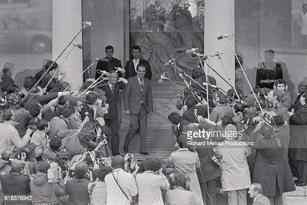 Secretary General of the French Communist Party Georges Marchais steps out to speak to the press in front of the Elysee Palace after attending a...