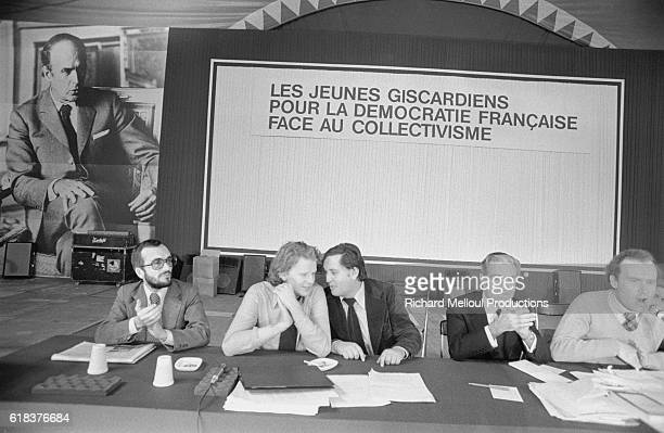 Secretary General of the Jeunes Giscardiens JeanPierre Raffarin speaks with a colleague at the third congress of the Jeunes Giscardiens a group of...