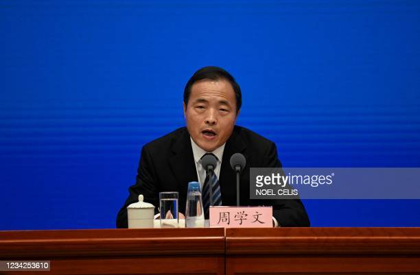 Secretary General of the National Flood Control and Drought Relief, Zhou Xuewen, speaks about the flooding in China's central Henan province, during...