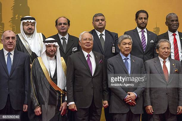 Secretary General of the OIC Yousef Bin Ahmad AlOthaimeen Malaysian Prime Minister Najib Razak and Foreign Minister of Malaysia Anifah Aman pose for...