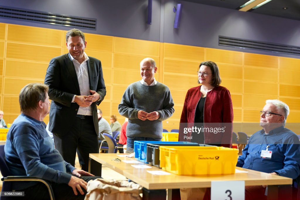 Secretary General of the Social Democratic Party (SDP) Lars Klingbeil, Mayor of Hamburg Olaf Scholz (SPD) and Bundestag faction leader of the German Social Democrats (SPD) Andrea Nahles attend the counting of the SPD members vote SPD headquarters, Willy Brandt House on March 3, 2018 in Berlin, Germany. The party's approximately 440,000 members are voting on whether to accept the coalition contract the party leadership recently hammered out with the German Christian Democrats (CDU/CSU) in order to create a new German government. The outcome is uncertain, as a large and vocal portion of the party is against the contract and seeks instead to keep the SPD in the opposition.