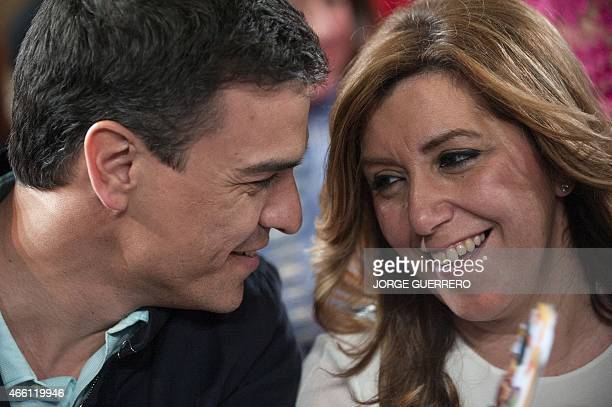 Secretary General of the Spanish Socialist Workers' Party Pedro Sanchez looks at Andalusia regional government president and party's candidate for...