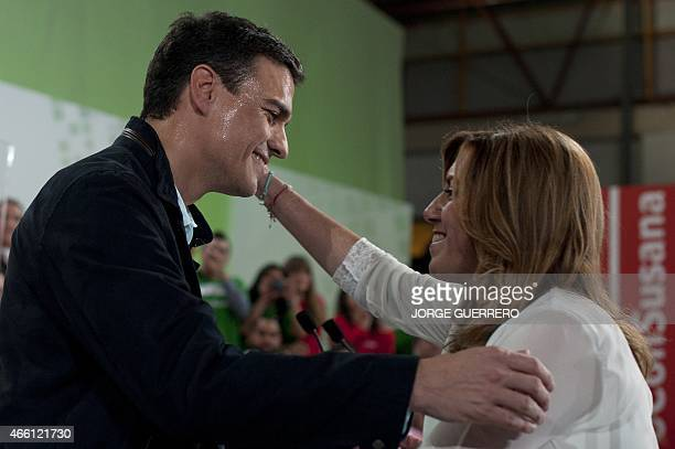 Secretary General of the Spanish Socialist Workers' Party Pedro Sanchez embraces Andalusia regional government president and party's candidate for...