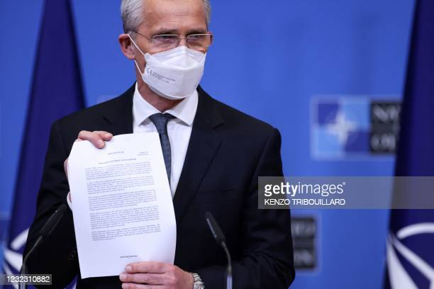 Secretary General of the Transatlantic Alliance NATO Jens Stoltenberg shows a document concerning Afghanistan during a joint press conference with US...
