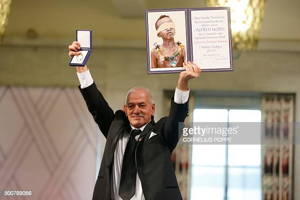 Secretary General of the Tunisian General Labour Union Houcine Abassi poses with the diploma and medallion during the Nobel Peace Prize award...