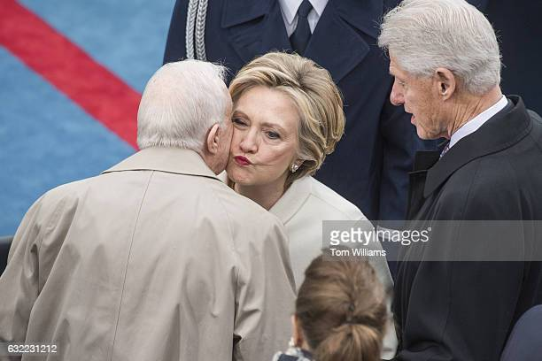 Secretary Hillary Clinton greets former President Jimmy Carter on the West Front of the Capitol before Donald J Trump was sworn in as the 45th...