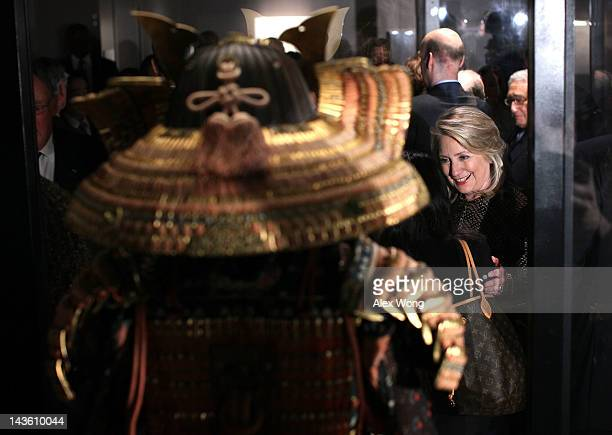 S Secretary Hillary Rodham Clinton greets guests as she visits the 'Samurai The Warrior Transformed' exhibition prior to the dinner she hosts for...