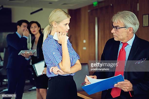 Secretary is flirting with her boss