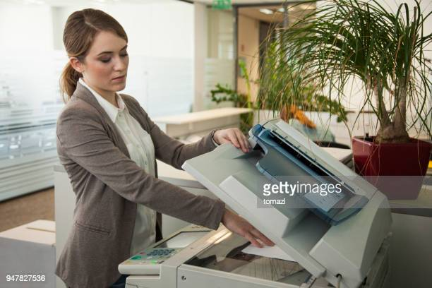 Secretary making copies of documents