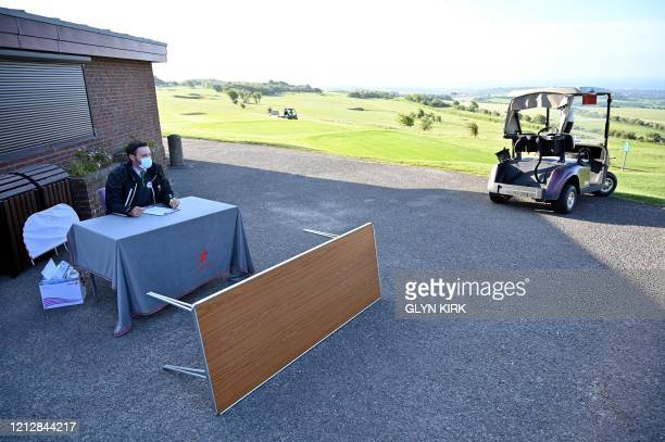 Secretary Martin Yeates waits for members at The Dyke Golf Club on the south coast of England on May 13 as the golf club reopens as restrictions are...