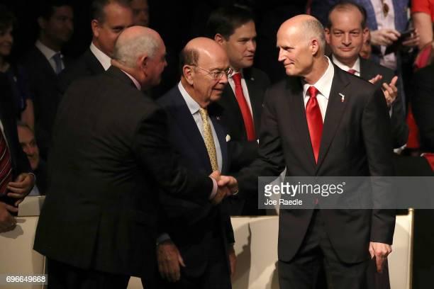Secretary of Agriculture Sonny Perdue and Secretary of Commerce Wilbur Ross greet Florida Gov Rick Scott ahead of US President Donald Trump...
