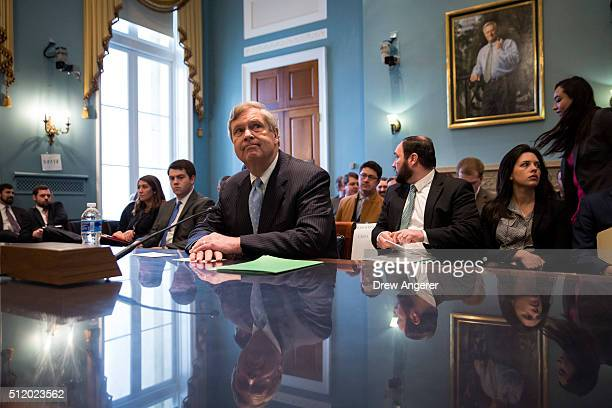S Secretary of Agriculture Tom Vilsack waits for the start of a House Committee on Agriculture hearing regarding the state of the rural economy on...