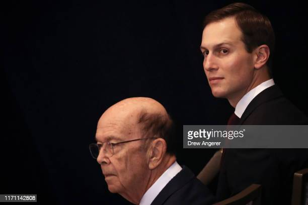 Secretary of Commerce Wilbur Ross and senior advisor Jared Kushner sit in the audience before the start of a press conference with President Donald...