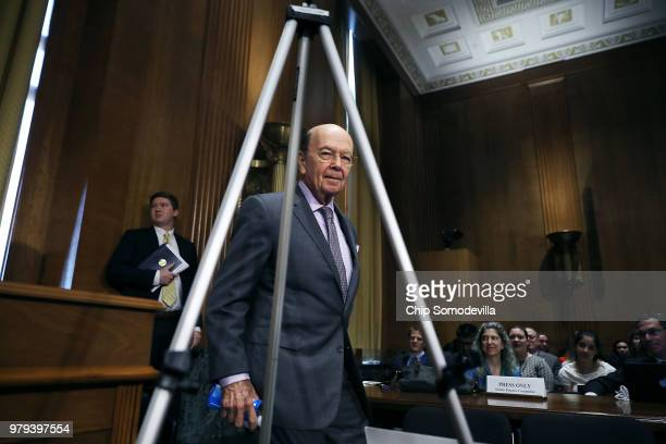 Senate Finance Committee Chairman Orrin Hatch and ranking member Sen Ron Wyden talk while hearing testimony from US Secretary of Commerce Wilbur Ross...