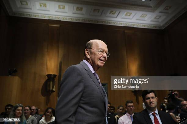 S Secretary of Commerce Wilbur Ross arrives before testifying to the Senate Finance Committee in the Dirksen Senate Office Building on Capitol Hill...