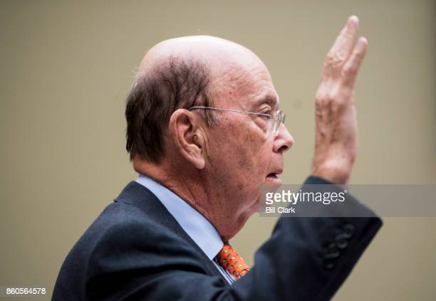 Secretary of Commerce Wilbur Ross is sworn in before testifying during the House Oversight and Government Reform Committee hearing on the census on...