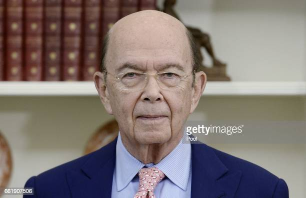 Secretary of commerce Wilbur Ross looks on before US President Donald Trump signs Executive Orders regarding trade in the Oval Office of the White...