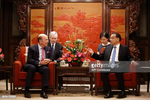 US Secretary of Commerce Wilbur Ross speaks with Chinese Premier Li Keqiang during their meeting at the Zhongnanhai state guesthouse in Beijing on...
