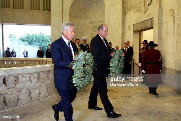 Secretary of Defence Chuck Hagel and Australian Defence Minister David Johnston attend a wreath laying ceremony on August 11, 2014 in Sydney,...