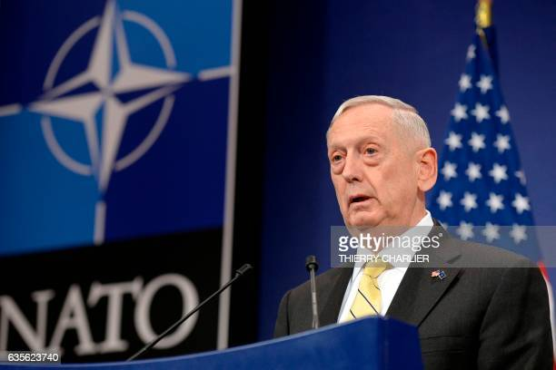 Secretary of Defence James Mattis delivers a speech during a press conference following the NATO Defence Ministers' meeting at NATO headquarter in...
