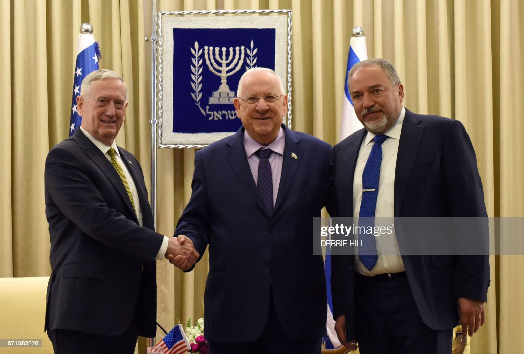 US Secretary of Defence James Mattis (L) shakes hands with Israeli President Reuven Rivlin (C) and Israeli Defence Minister Avigdor Lieberman (R) at the president's residence in Jerusalem on April 21, 2017. /