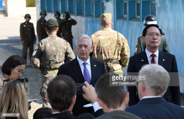Secretary of Defence Jim Mattis speaks to the media as South Korean Defence Minister Song Young-Moo looks on during a visit to the truce village of...