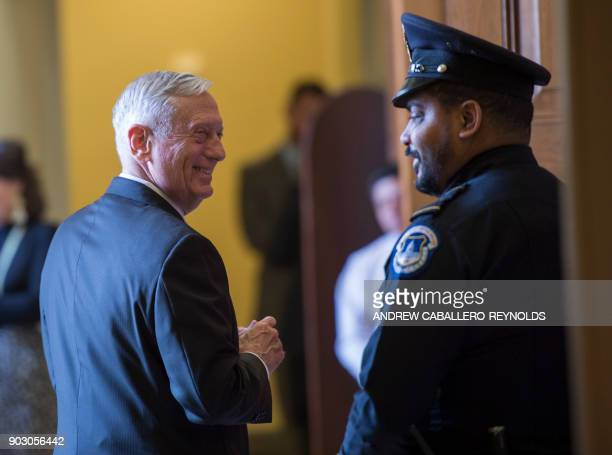 US Secretary of Defence Jim Mattis speaks with a police officer as he waits for the start of a Republican Stentors luncheon on Captiol Hill in...