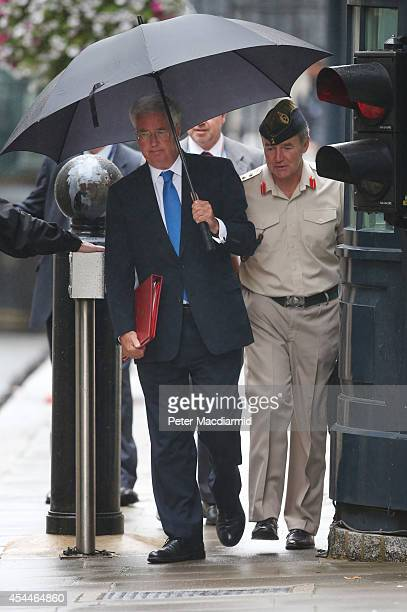Secretary of Defence Michael Fallon walks into Downing Street with Chief of the Defence Staff General Sir Nicholas Houghton on September 1 2014 in...