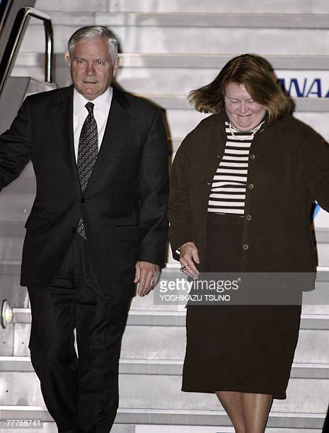 US Secretary of Defence Robert Gates accompanied by his wife Becky arrive at the Tokyo International Airport 07 November 2007 Gates is now here on a...