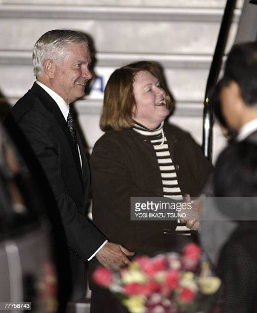 US Secretary of Defence Robert Gates accompanied by his wife Becky is greeted by wellwishers upon arrival at the Tokyo International Airport 07...