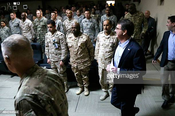 S Secretary of Defense Ash Carter arrives to address troops at Camp Arifjan on February 23 2015 in Kuwait Carter will chair a meeting on Monday of...