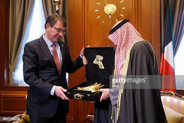 S Secretary of Defense Ash Carter receives a gift of a golden model of a sailing ship from Kuwait's Defense Minister Sheikh Khalid alJarrah alSabah...