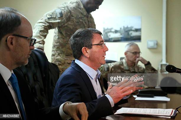 S Secretary of Defense Ash Carter sits down to a regional security meeting with US Ambassador to Kuwait Douglas Silliman US Army General Lloyd Austin...
