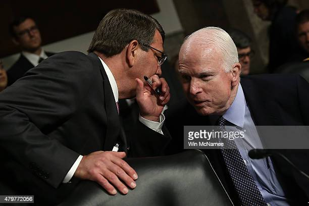 Secretary of Defense Ashton Carter confers with committee chairman Sen. John McCain prior to a hearing held by the Senate Armed Services Committee...