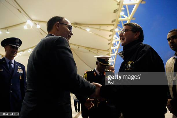 S Secretary of Defense Ashton Carter is greeted by US Ambassador to Kuwait Douglas Silliman as Carter arrives at Kuwait City International Airport...