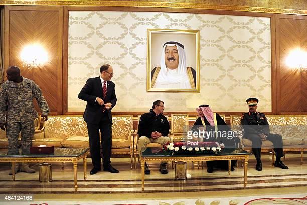 S Secretary of Defense Ashton Carter meets with Kuwait's Defense Minister Sheikh Khalid alJarrah alSabah beneath a picture of Kuwaiti Emir Sabah...