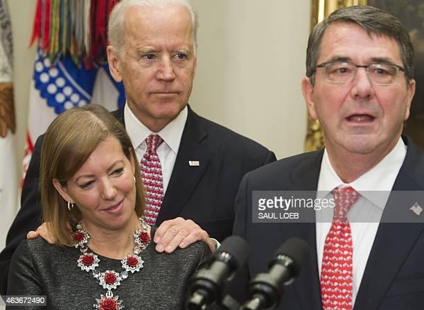 Secretary of Defense Ashton Carter speaks alongside his wife Stephanie and US Vice President Joe Biden during a swearingin ceremony in the Roosevelt...