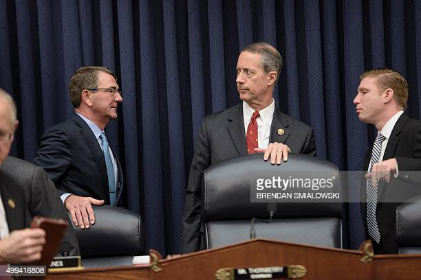Secretary of Defense Ashton Carter walks past Committee Chairman Mac Thornberry as he arrives for a hearing of the House Armed Services Committee on...
