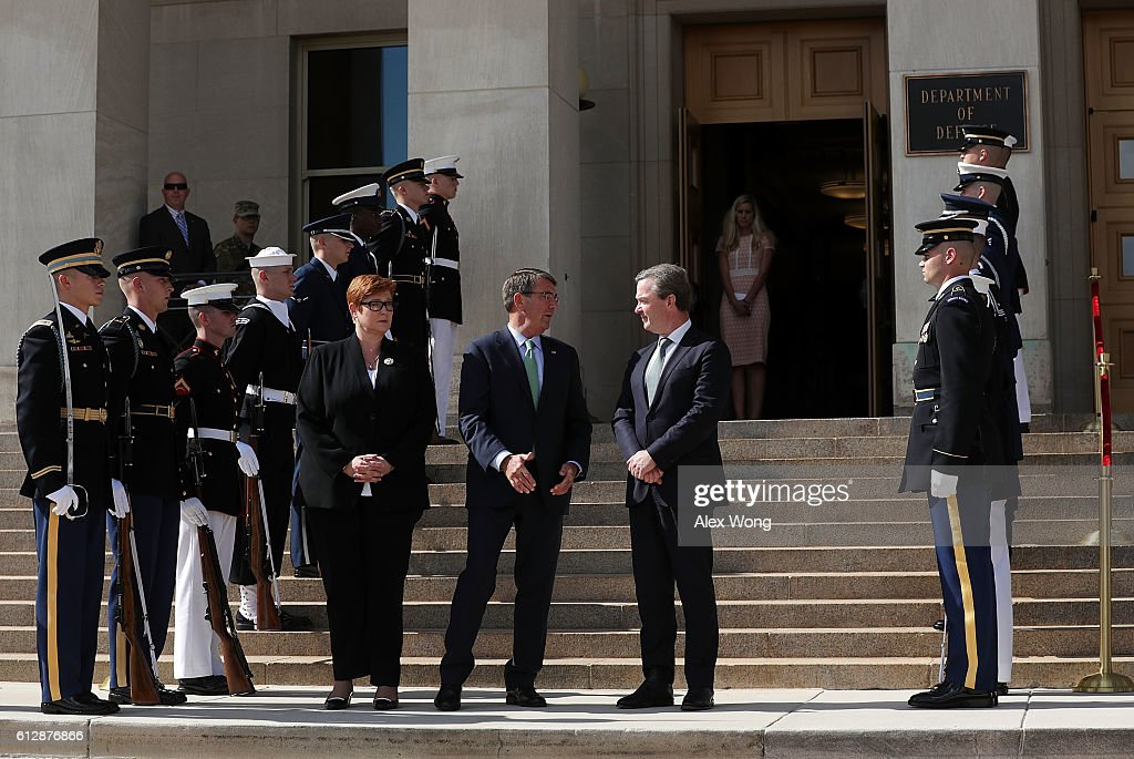 U.S. Secretary of Defense Ashton Carter (2nd L) welcomes Australian Defense Minister Marise Payne (L) and Australian Minister for Defense Industry Christopher Pyne (R) during an enhanced honor cordon October 5, 2016 at the Pentagon in Arlington, Virginia. Minister Payne and Minister Pyne are expected to hold talks with Carter on the fight against Islamic State and regional engagement.