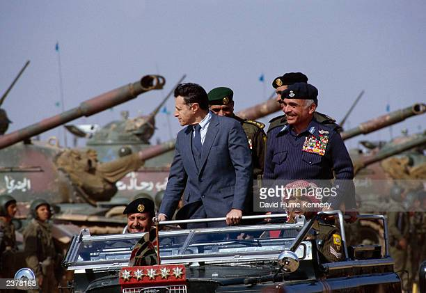 US Secretary of Defense Casper Weinberger rides in an open car with King Hussein during a 1982 visit outside of Amman Jordan