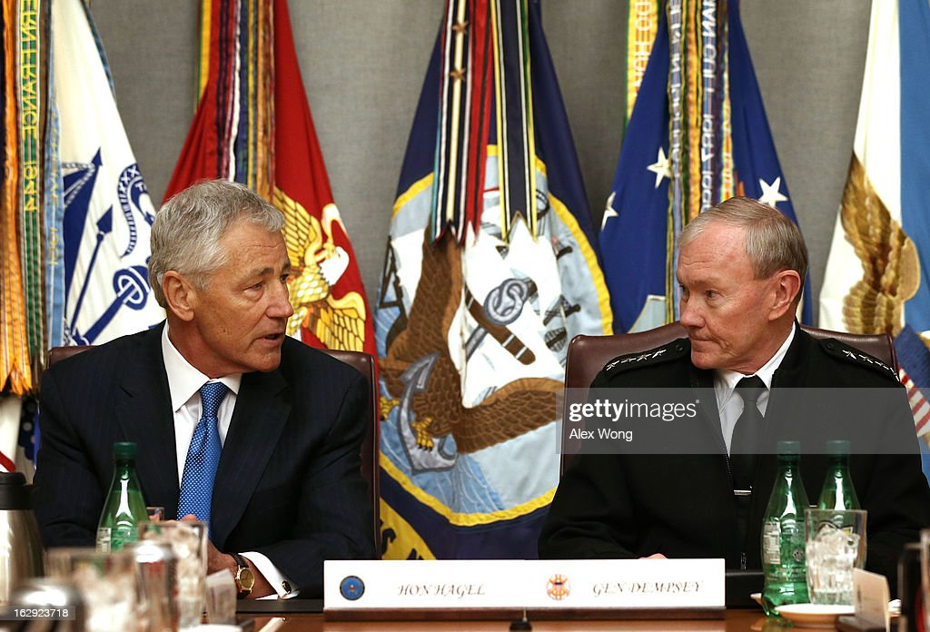 U.S. Secretary of Defense Chuck Hagel (L) and Chairman of the Joint Chiefs of Staff General Martin Dempsey attend a meeting at the Joint Chiefs Conference Room, also known as the 'tank,' March 1, 2013 at the Pentagon in Arlington, Virginia. Secretary Hagel participated in a meet-and-greet with the members of the Joint Chiefs of Staff.