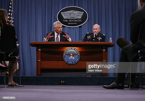Secretary of Defense Chuck Hagel and Chairman of the Joint Chiefs of Staff Gen Martin E Dempsey speak during a media briefing at the Pentagon May 17...