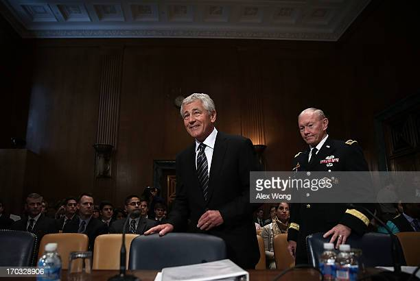 S Secretary of Defense Chuck Hagel and Chairman of the Joint Chiefs of Staff General Martin Dempsey arrive at a hearing before the Defense...