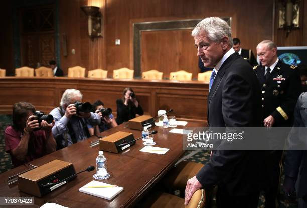 S Secretary of Defense Chuck Hagel and Chairman of the Joint Chiefs of Staff General Martin Dempsey arrive at a hearing before the Senate Budget...